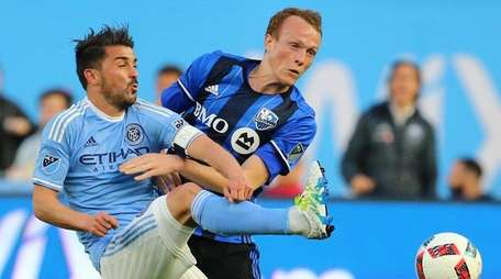 NYCFC's David Villa collides with Wandrille Lefevre of