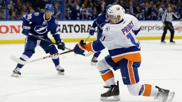 New York Islanders' Shane Prince (11) scores his