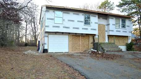 This house in Central Islip, shown on Friday,