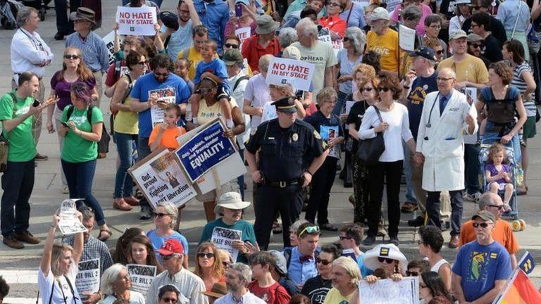 Protesters head into the Legislative building for a