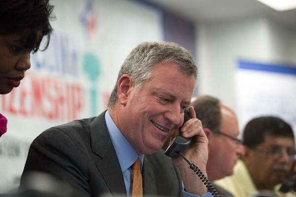 Mayor Bill de Blasio takes a phone call