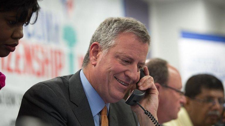 Mayor Bill de Blasio takes a phone call