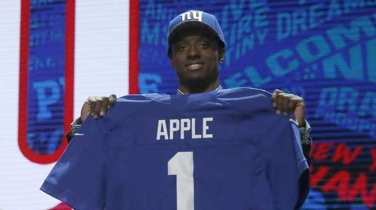 Ohio State's Eli Apple poses for photos after