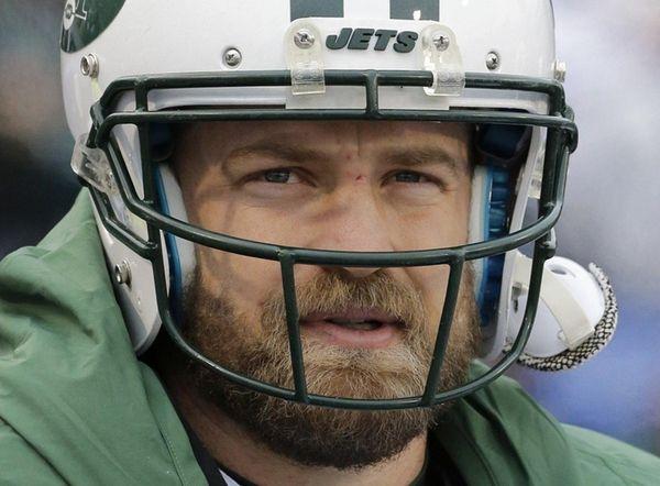 New York Jets quarterback Ryan Fitzpatrick watches his