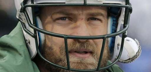 New York Jets quarterback Ryan Fitzpatrick watches his