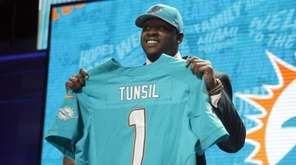Mississippi's Laremy Tunsil poses for photos after being