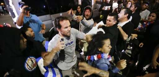 A Donald Trump supporter clashes with protesters outside