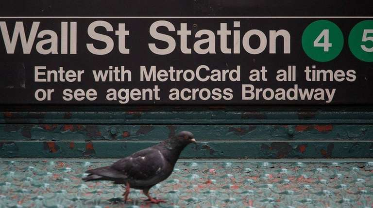 A pigeon underneath the Wall Street subway station