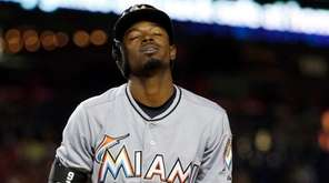The Miami Marlins' Dee Gordon reacts after