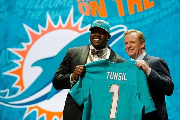 Laremy Tunsil of Ole Miss holds up