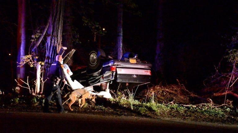 Suffolk County police investigate the scene where an
