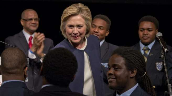 Democratic presidential candidate Hillary Clinton greets students of