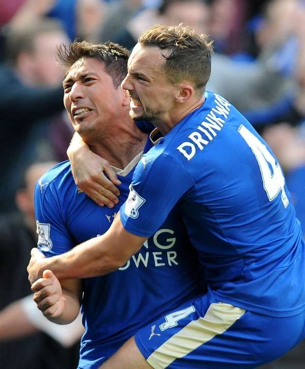 Leicester City's Leonardo Ulloa celebrates with teammate