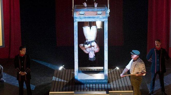 Michael Weston portrays escape artist Harry Houdini in