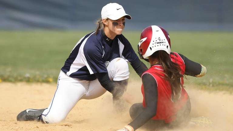 Connetquot's Julianna Prescia (4 )gets tagged out stealing