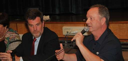 Harborfields school board vice president Donald Mastroianni, right,