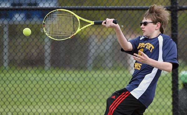 Northport's Jack Leonard makes forehand return against Harborfields