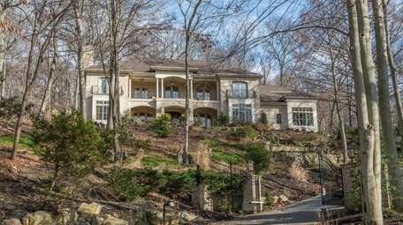 This brick home overlooking the Nissequogue River has