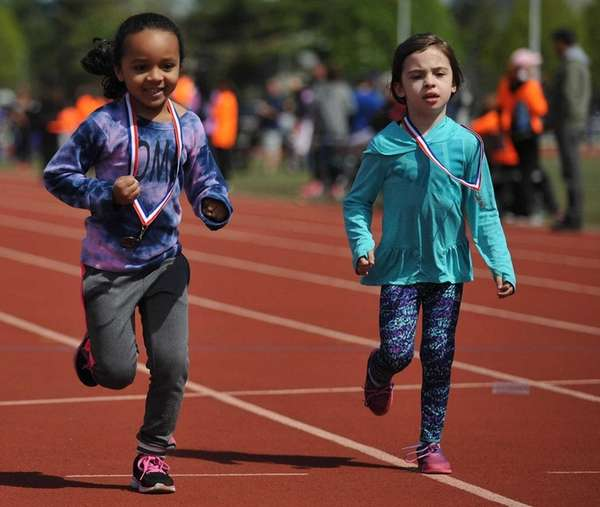 Sienna Pearson, 5, of Westbury, left, and her