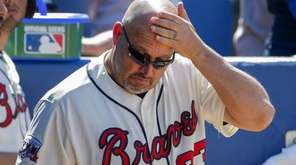 Atlanta Braves manager Fredi Gonzalez reacts in the