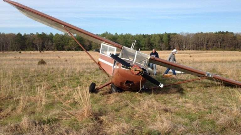 A 1947 Stinson fixed-wing aircraft landed on its