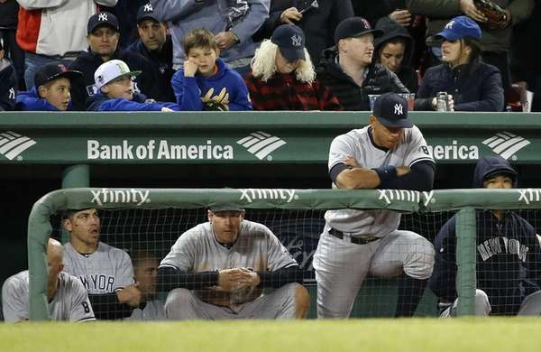 New York Yankees' Alex Rodriguez, second from right,