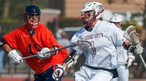 Garden City's JP Basile (1, right), against Manhasset's