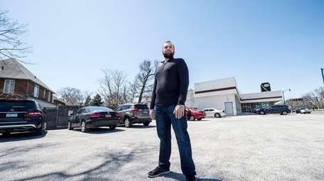 Lynbrook resident Joseph Gallo stands on the property