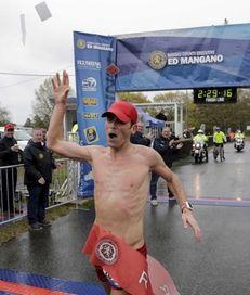 Oz Pearlman, winner of the 26.2-mile marathon, crosses
