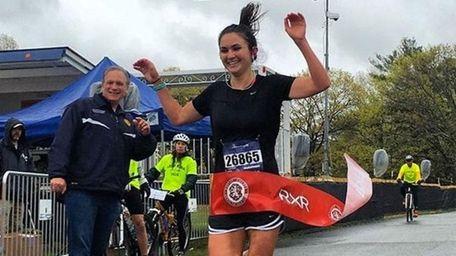 Amanda Filiberto crosses the finish line at the