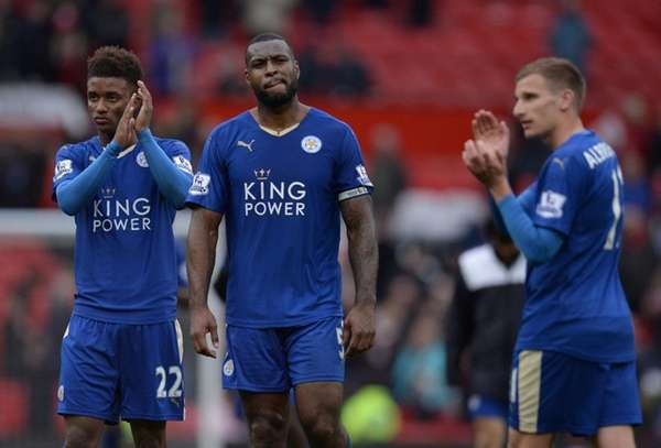 Leicester City's English defender Wes Morgan, center,