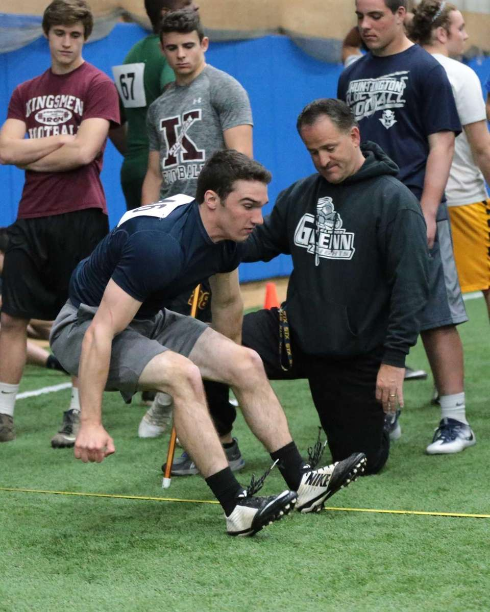 Northport's Ryan Elliot completes the broad jump during