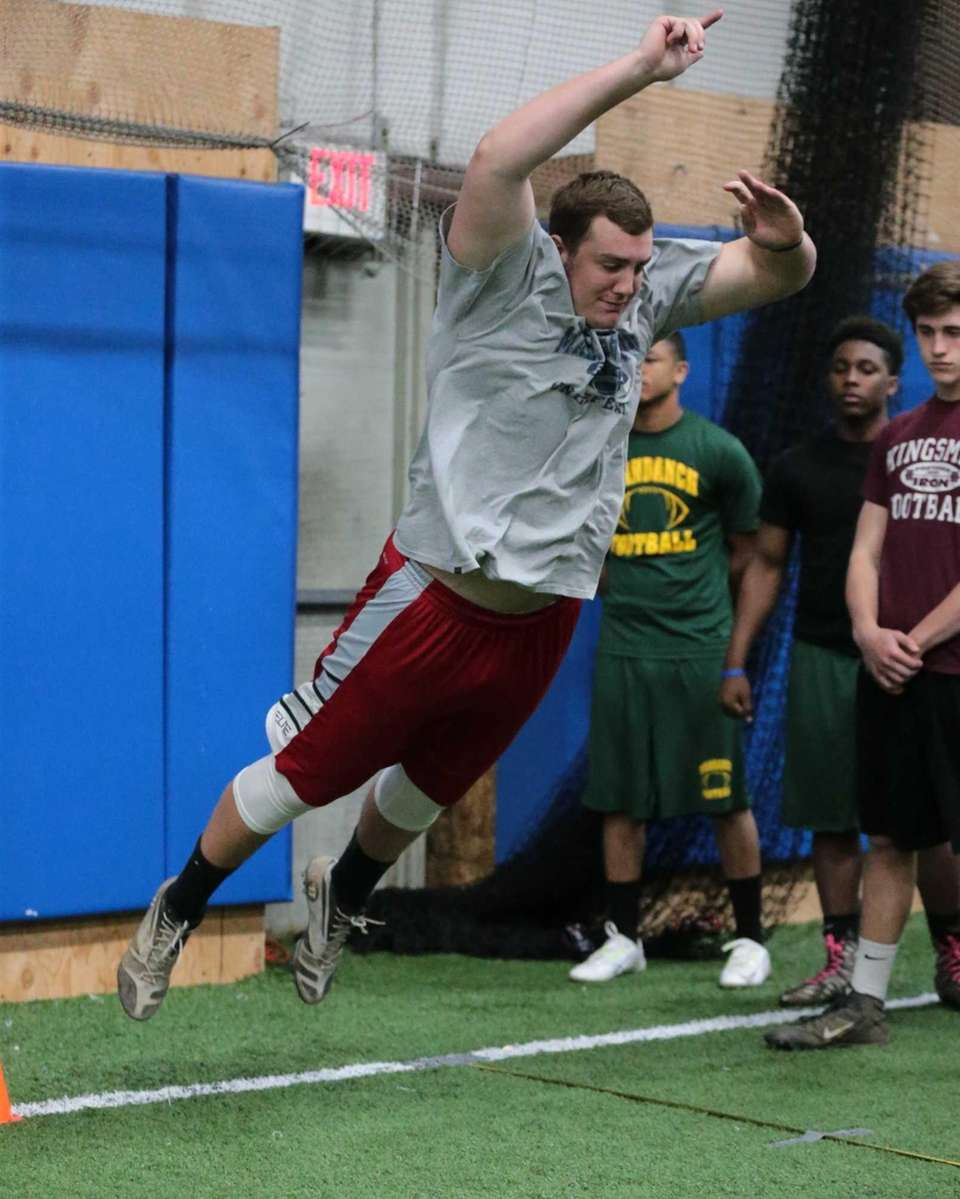 Shoreham-Wading River's Ethan Weiderkehr completes the broad jump