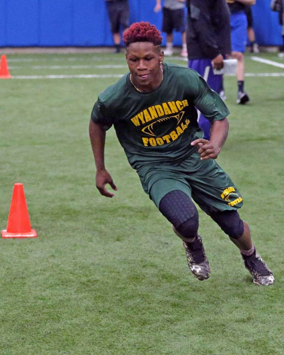 Wyandanch's Alonte Shipp runs the three-cone drill during