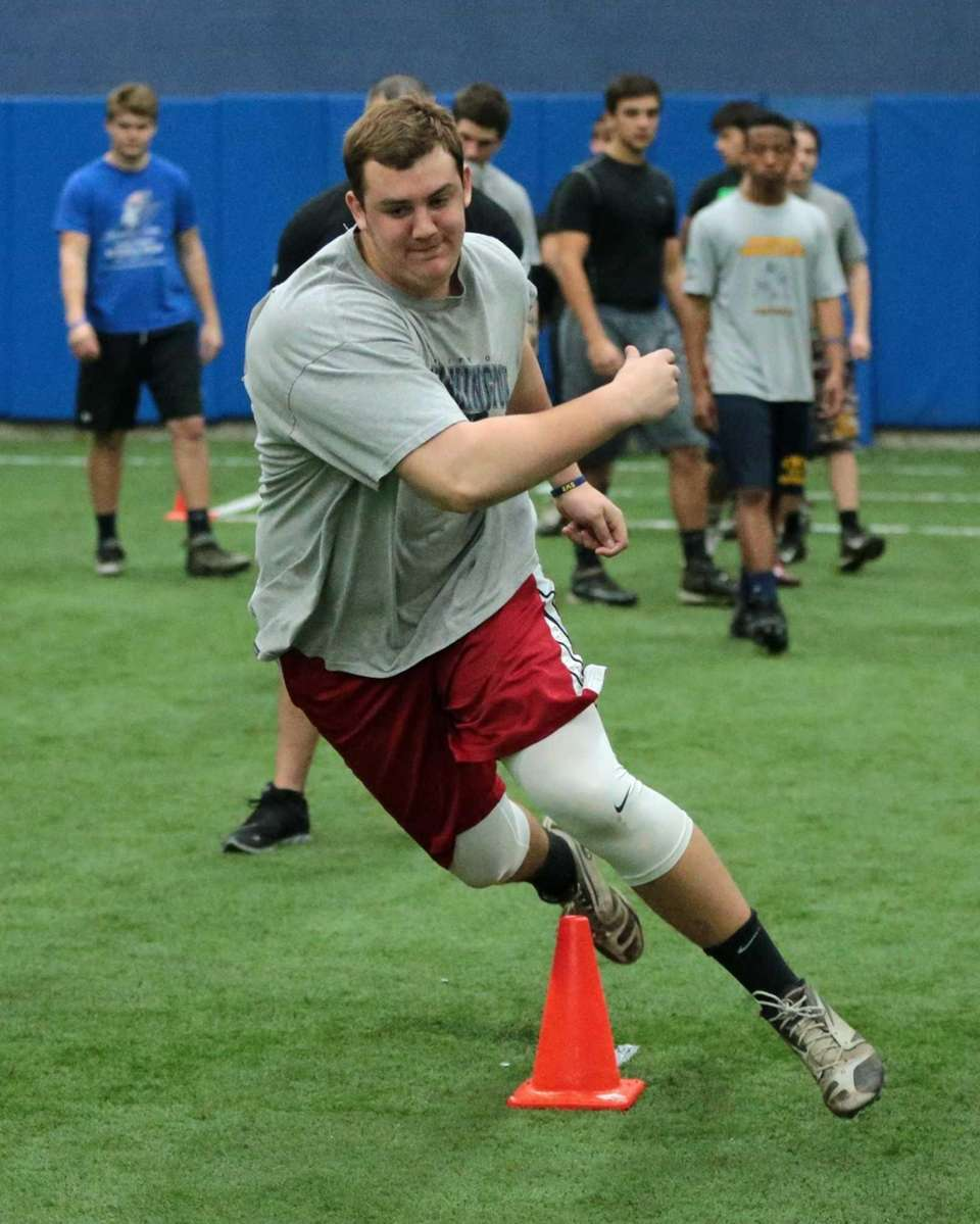 Shoreham-Wading River's Ethan Weiderkehr runs the three-cone drill