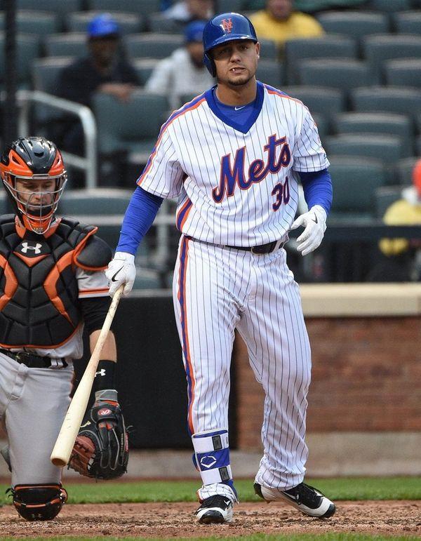 New York Mets leftfielder Michael Conforto reacts