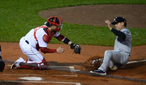 Boston Red Sox catcher Christian Vazquez tags