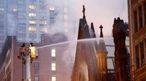 Firefighters battle flames at the historic Serbian Orthodox