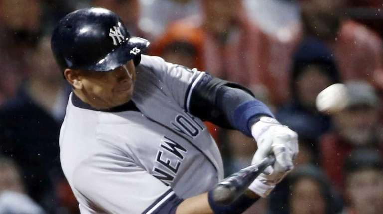 The New York Yankees' Alex Rodriguez hits a