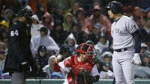 The New York Yankees' Alex Rodriguez, right, has