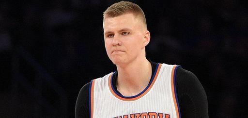 New York Knicks forward Kristaps Porzingis reacts