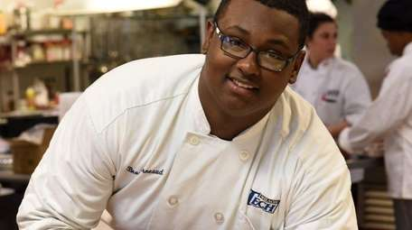 Bruce Arneaud, 18, a culinary student at Wilson