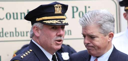 Then-Suffolk County Police Chief James Burke speaks with