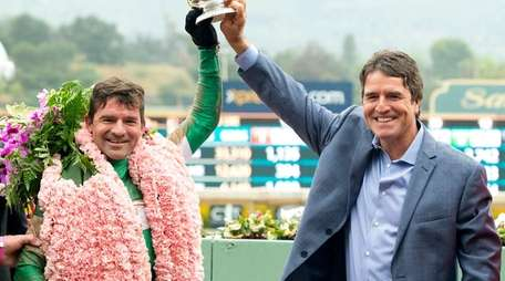 Jockey Kent Desormeaux, left, and trainer Keith Desormeaux