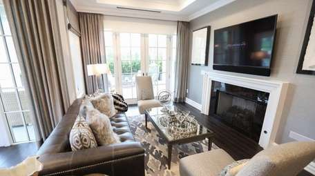The living room inside a staged 1940-square-ft. condominum