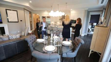 A dining area inside a staged 1940-square-ft. condominum