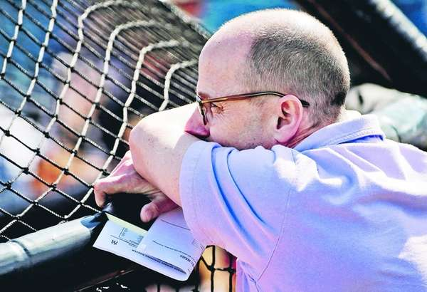 New York Yankees general manager Brian Cashman watches