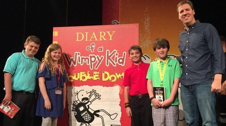 Author Jeff Kinney with Kidsday reporters (l) David