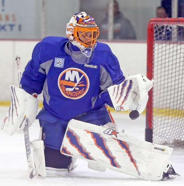 Jaroslav Halak gets a glove on the puck