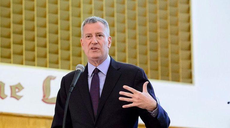 New York City Mayor Bill de Blasio, above,